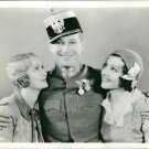 Maurice Auguste Chevalier with two another women on both the sides. - 8x10 photo