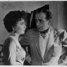 Humphrey Bogart and Gina Lollobrigida in a movie scene. - 8x10 photo