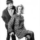 Catherine Deneuve and a man posing. - 8x10 photo