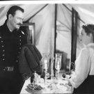 John Wayne and Maureen O'Hara standing, face to face. - 8x10 photo