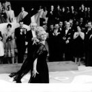 Brigitte Bardot in a black gown smiling at crowd. - 8x10 photo