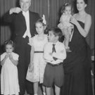 Charlie Chaplin and Oona O'Neill with their family.  - 8x10 photo