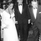 Elizabeth Taylor holding hand of her husband Richard Burton.   - 8x10 photo