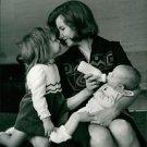 Eddy Merckx's wife feeding her child, playing.  - 8x10 photo
