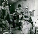 Brigitte Bardot resting on set of Famous Love Affairs.  - 8x10 photo