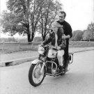 Mylene Demongeot enjoying a bike ride with her husband. - 8x10 photo