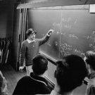 Évariste standing in front of blackboard, Princeton University. - 8x10 photo