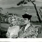 Bob Hope sitting with a woman, facial expression.  - 8x10 photo