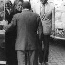 Richard Burton and his wife Elizabeth Taylor meets a man. - 8x10 photo