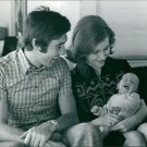 Eddy Merckx sitting with his wife and child. - 8x10 photo