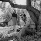 Clark Gable sitting under tree and Greer Garson standing. - 8x10 photo