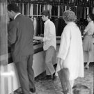 "Robert Francis ""Bobby"" Kennedy at a cloth store. - 8x10 photo"