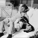 "Robert Francis ""Bobby"" Kennedy relaxing with a child and dog. - 8x10 photo"