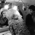 Catherine Deneuve looking at herself in mirror, with David Bailey. - 8x10 photo