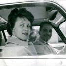 Hussein bin Talal sitting inside the car with his wife.  - 8x10 photo