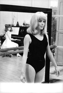 Catherine Deneuve in ballet costume with Françoise Dorléac at piano. - 8x10 phot