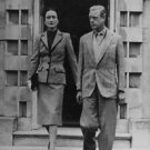 The Duke and Duchess of Windsor walking out holding hands. - 8x10 photo