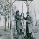 An allied guard at Vught shows a visitor one of the torture gibbots erected by t