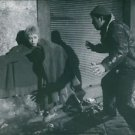 Anthony Quinn and Giulietta Masina in street at night during a scene from the fi