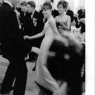 Audrey Hepburn with Mel Ferrer, performing twist. - 8x10 photo