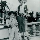 Zsa Zsa Gabor and child in cowboy costumes. - 8x10 photo