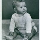 An adorable child sitting and looking at something. - 8x10 photo