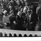 John Fitzgerald Kennedy surrounded by the crowd, greeting guests.  - 8x10 photo