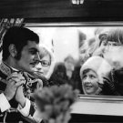 Omar Sharif in uniform on set of Mayerling, with people looking in through windo