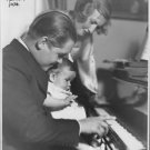 "Johan Jonatan ""Jussi"" Björling with his family and playing piano. - 8x10 photo"