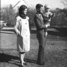 John F. Kennedy and Jacqueline Kennedy with one of their children. - 8x10 photo