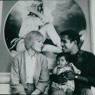 Sammy Davis Jr. with his wife May Britt and child. - 8x10 photo