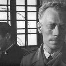 Gunnnar Björnstrand standing behind Max von Sydow in Winter Light. - 8x10 photo