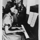 Sophia Loren playing piano.  - 8x10 photo
