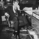 """Robert Francis """"Bobby"""" Kennedy on a telephone receiver. - 8x10 photo"""