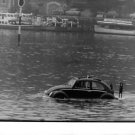 VolksWagen Type 82E is about to sink in the river. - 8x10 photo