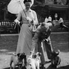 Duke of Windsor playing with dogs while Wallis, Duchess of Windsor looks on. - 8