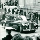 Queen Elizabeth in a car, military man saluting. - 8x10 photo