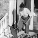 Katherine Hepburn on balcony.  - 8x10 photo