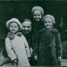 Italo Balbo standing with children, Paolo Balbo, Valeria Balbo and Giuliana Balb