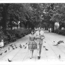 Gregory Peck walking on park with his wife Veronique Peck. - 8x10 photo
