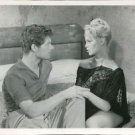 Brigitte Bardot and Stephen Boyd sitting on bed on set of The Night Heaven Fell.