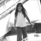 Maria Burton on a boat. - 8x10 photo
