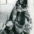 Salvador Dali wearing sunglasses, woman posing.   - 8x10 photo