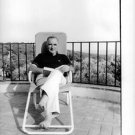 Georges Jean Raymond Pompidou relaxing on a lounge chair. - 8x10 photo