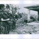 General William Peers recording on something in Vietnam. - 8x10 photo