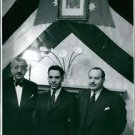 Hussein bin Talal standing with people and looking at camera.  - 8x10 photo