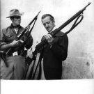 David Niven checking rifle.  - 8x10 photo