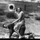 A woman is having fun on the back of man.  couple, piggy back, fun, togetherne