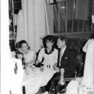 Audrey Hepburn sitting with Mel Ferrer and Capucine, enjoying drinks. - 8x10 pho