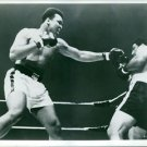 Muhammad Ali during an on going boxing match with his opponent. - 8x10 photo